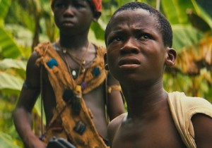 Abraham Attah as Agu on the right. Emmanuel Nii Adom Quaye as Strika in the back.